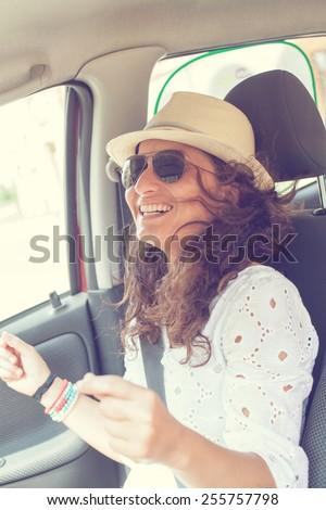 happy woman having fun in the car - stock photo