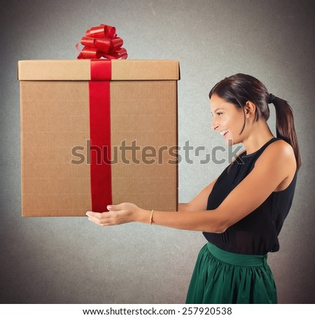 Happy woman having received the gift expected - stock photo