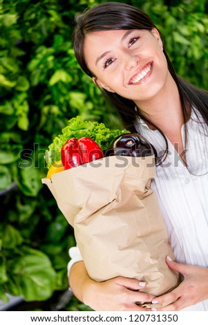Happy woman healthy shopping at the supermarket - stock photo