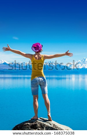 Happy Woman hiking in the mountains - stock photo