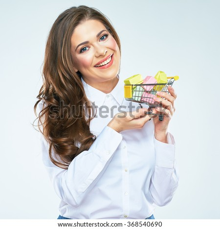 Happy woman hold market cart with presents. White background isolated. Long curly hair.