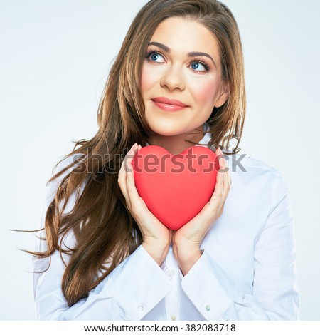 Happy woman hold red heart. Long curly hair. Beautiful female model posing on isolated white background.