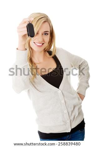 Happy woman holding a car key. - stock photo