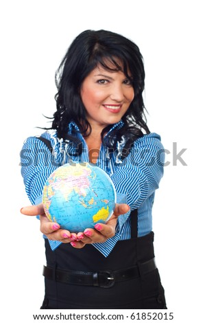 Happy woman holding a globe in her hands in front of camera   isolated on white background,selective focus on earth globe
