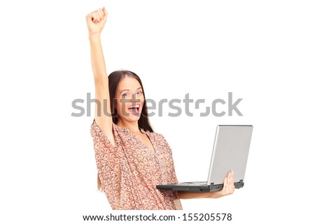 Happy woman holding a laptop with raised hand isolated on white background