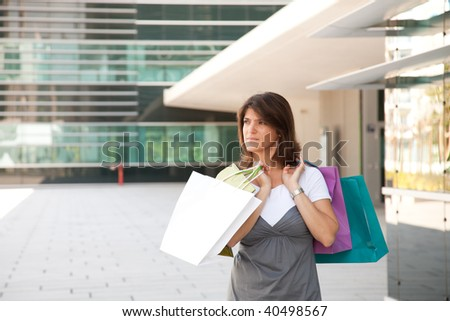 happy woman holding a lot of shopping bags - stock photo