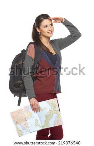 Happy woman holding a map and looking forward, isolated over a white background - stock photo