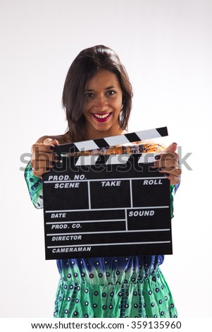 Happy woman holding a movie clapper - stock photo