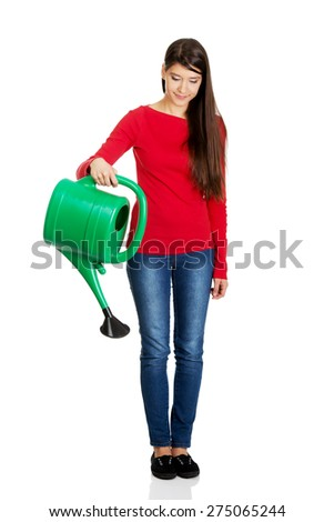 Happy woman holding a watering can. - stock photo
