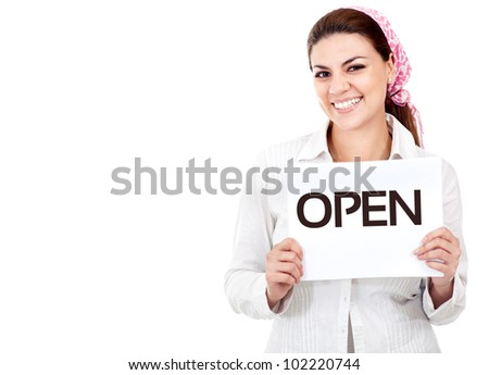 Happy woman holding an open sign - isolated over a white background - stock photo