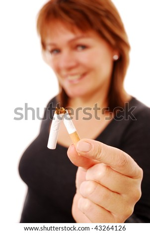 Happy woman holding broken cigarette (focus on cigarette) over white background