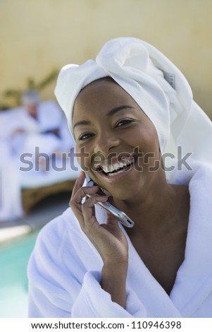Happy woman holding cellphone - stock photo
