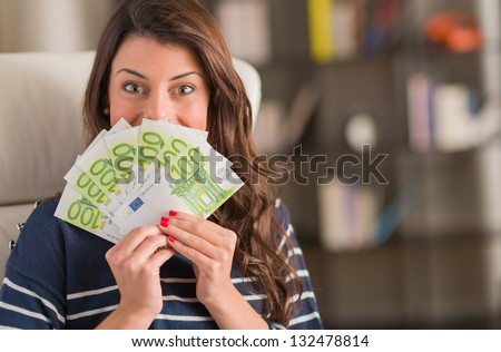 Happy Woman Holding Euro Currency, Indoors - stock photo