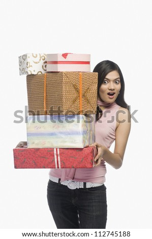 Happy woman holding gifts