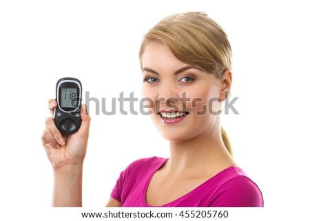Happy woman holding glucose meter with positive result of measurement sugar level, concept of diabetes, checking and measuring sugar level - stock photo