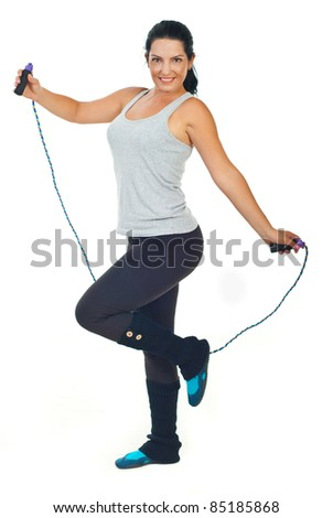 Happy woman holding jump rope isolated on white background