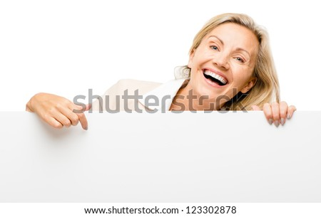 Happy woman holding placard smiling isolated on white background - stock photo