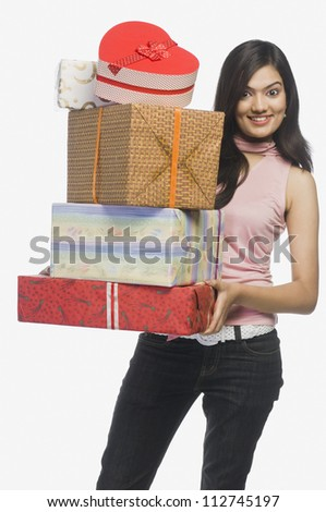 Happy woman holding presents