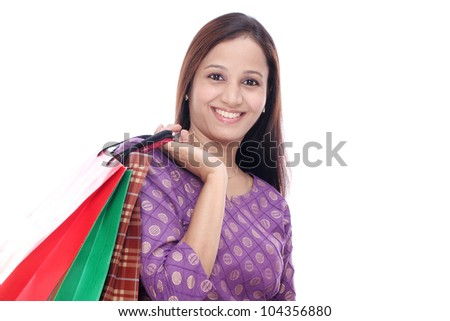 Happy Woman holding shopping bags against a white background