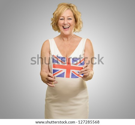 Happy Woman Holding United Kingdom Flag On Gray Background