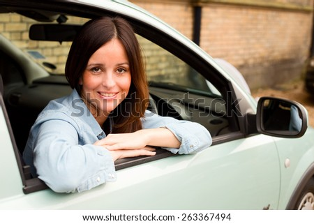 happy woman in a car - stock photo