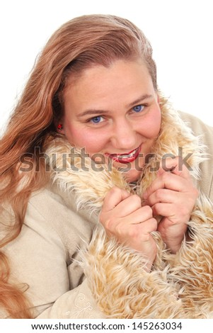 Happy woman in a coat with fur
