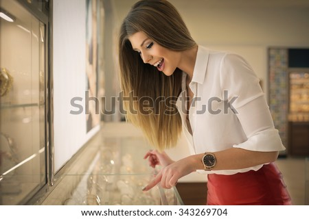 Happy woman in a jewelry - stock photo