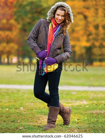 happy woman in automn scenery in the parc - stock photo