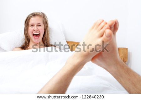 Happy woman  in bed.