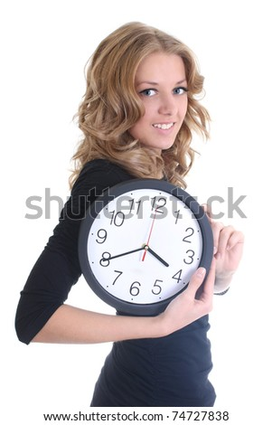 Happy woman in black with clock over white