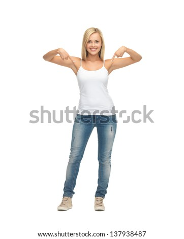 happy woman in blank white t-shirt pointing at herself