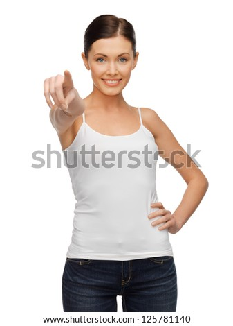 happy woman in blank white t-shirt pointing her finger - stock photo