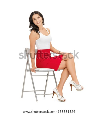 happy woman in casual clothes sitting on chair - stock photo