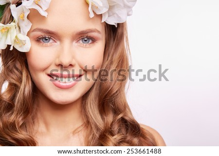 Happy woman in floral wreath - stock photo