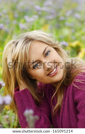 Happy woman in flower field