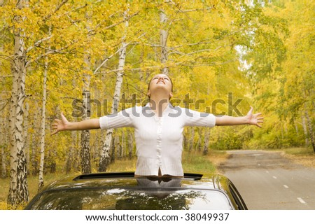happy woman in her car