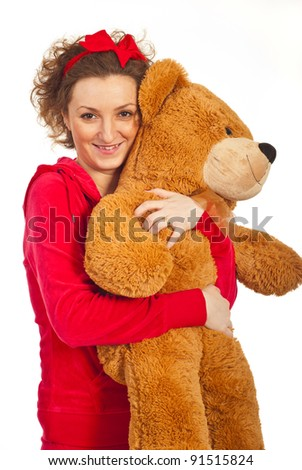 Happy woman in pajamas hugging teddy bear isolated on white background - stock photo