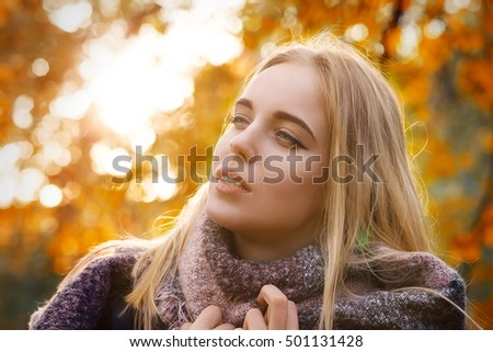 happy woman in park at autumn sunset, toned image