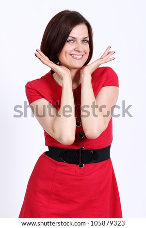 Happy woman in red dress.