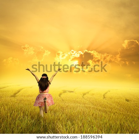 Happy woman  in rice field and sunset