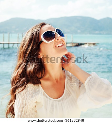 Happy woman in summer white dress on beach. - stock photo