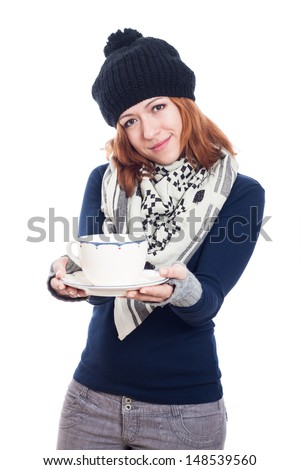 Happy woman in winter clothes holding mug of tea or coffee, isolated on white background. - stock photo