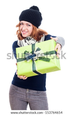 Happy woman in winter hat giving present, isolated on white background. - stock photo