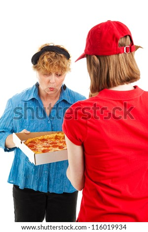 Happy woman inspects the pizza she's having delivered by a delivery girl. - stock photo