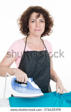 Happy woman ironing cloth with electric iron isolated on white - stock photo