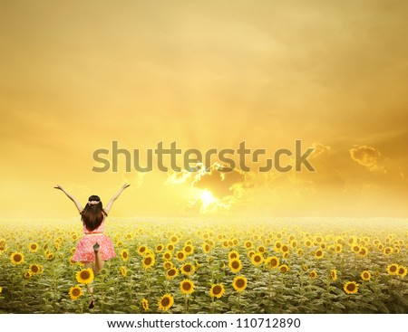 Happy woman jump in sunflower fields and sunset