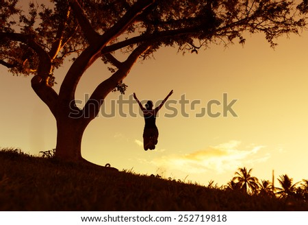 Happy woman jumping. Freedom concept. Enjoyment. - stock photo