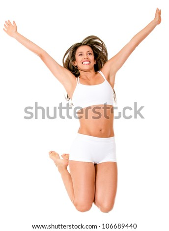 Happy woman jumping in her underwear - isolated over a white background - stock photo