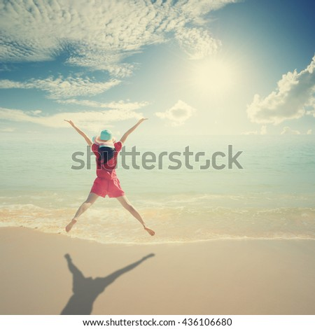 Happy Woman jumping on the beach and sun sky,summer holiday vacation concept.Vintage Tone - stock photo