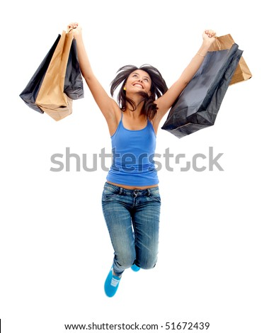 happy woman jumping with shopping bags isolated over a white background